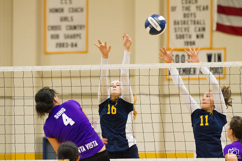 Milpitas seniors Taylor Davis (16) and Pilar Ferguson (11) attempt to block a Monta Vista High School spike on Sept. 10, 2012.  Milpitas would go on to lose in 4 sets, 7-25, 16-25, INSERT SCORE, 17-25.  Photo by Stan Olszewski/SOSKIphoto.