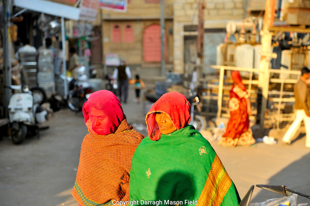 Two veiled women walking the street in Jaisalmer, Rajasthan
