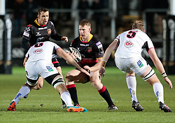 Dragons' Jack Dixon under pressure from Ulster's Greg Jones<br /> <br /> Photographer Simon King/Replay Images<br /> <br /> Guinness Pro14 Round 10 - Dragons v Ulster - Friday 1st December 2017 - Rodney Parade - Newport<br /> <br /> World Copyright © 2017 Replay Images. All rights reserved. info@replayimages.co.uk - www.replayimages.co.uk