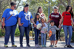 From left, Nadia Clarke, Adrienne Dixson Paul, Claudia Barwinski, Sophia Ibraham, 10, Elena Ibraham, 6, Oliver Bulleman, 4, Nathalie Bulleman, and Amy Paulson stop for a moment of silence at 10:17 a.m. at Pine Trails Park in Parkland, Fla., in honor of all 17 of the victims killed last year at the school. Photo by Mike Stocker/Sun Sentinel/TNS/ABACAPRESS.COM