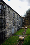 30166675A VERSAILLES, Ky. - Nov. 7, 2014 - A full bourbon barrel Barrels rolls down the tracks to others waiting to be stored at the Woodford Reserve Distilleries barrel warehouse. The warehouse is the only limestone building used to store bourbon. <br /> <br /> William DeShazer for the New York Times
