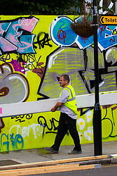 Workmen erect hoardings around Paul Smith's HQ just off Portobello Road as shops and properties in the west London area of the Notting Hill Carnival prepare for the hundreds of thousands of revellers by erecting protective hoardings. London, August 24 2018.