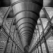 The gloominess of the interior of the Library at Trinity College Dublin fascinated me. I spent some time soaking up the atmosphere before deciding on an almost abstract shot. To me this represented the relentless passing of time turning current ideas into ancient history.<br /> <br /> Awarded PSA Bronze Medal at the Bristol Salon of Photography 2020