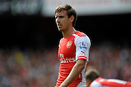 Arsenal's Nacho Monreal looks on. Barclays Premier league match, Arsenal v Manchester city at the Emirates Stadium in London on Saturday 13th Sept 2014.<br /> pic by John Patrick Fletcher, Andrew Orchard sports photography.