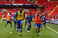 Shrewsbury Town defender Omar Beckles (6) and Shrewsbury Town midfielder Shaun Whalley (7) warm up with teammates during the EFL Sky Bet League 1 match between Charlton Athletic and Shrewsbury Town at The Valley, London, England on 11 August 2018.