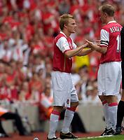 Photo: Daniel Hambury.<br />Arsenal v Ajax. Dennis Bergkamp Testimonial. 22/07/2006.<br />Arsenal's Dennis Bergkamp comes off in the first half for Seb Larsson.