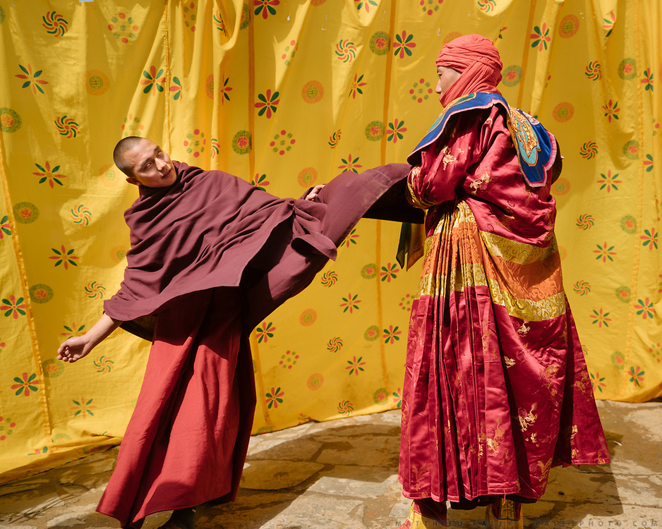 Back stage, monks practice dancing. The Tshechu of the Gasa monastery on the road leading to Laya. Tshechu are annual religious Bhutanese festivals held in each district on the tenth day of a month of the lunar Tibetan calendar. Tshechus are large social gatherings, which perform the function of social bonding among people of remote and spread-out villages.