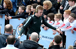 Manchester City's Kevin De Bruyne acknowledges the fans as he arrives at the stadium before the match begins