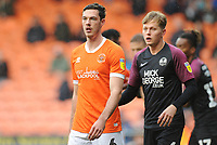 Blackpool's Ben Heneghan under pressure from Peterborough United's Frankie Kent<br /> <br /> Photographer Kevin Barnes/CameraSport<br /> <br /> The EFL Sky Bet Championship - Blackpool v Peterborough United - Saturday 2nd November 2019 - Bloomfield Road - Blackpool<br /> <br /> World Copyright © 2019 CameraSport. All rights reserved. 43 Linden Ave. Countesthorpe. Leicester. England. LE8 5PG - Tel: +44 (0) 116 277 4147 - admin@camerasport.com - www.camerasport.com
