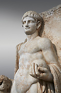 Detail of a Roman Sebasteion relief  sculpture of Emperor Nero , Aphrodisias Museum, Aphrodisias, Turkey. <br /> <br /> Naked warrior emperor Nero holds the orb of world rule in one hand and crowns the military trophy with the other. Between the trophy and the emperor stands a bound captive boy. He wears long barbarian trousers and looks up at Nero. .<br /> <br /> If you prefer to buy from our ALAMY STOCK LIBRARY page at https://www.alamy.com/portfolio/paul-williams-funkystock/greco-roman-sculptures.html . Type -    Aphrodisias     - into LOWER SEARCH WITHIN GALLERY box - Refine search by adding a subject, place, background colour, museum etc.<br /> <br /> Visit our ROMAN WORLD PHOTO COLLECTIONS for more photos to download or buy as wall art prints https://funkystock.photoshelter.com/gallery-collection/The-Romans-Art-Artefacts-Antiquities-Historic-Sites-Pictures-Images/C0000r2uLJJo9_s0