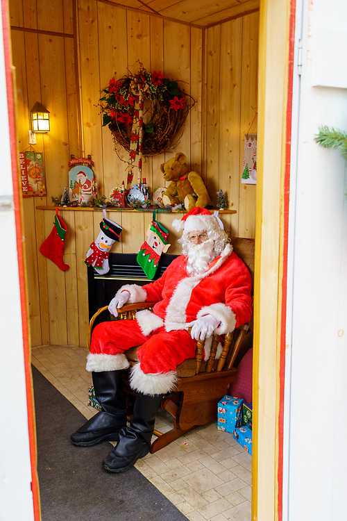 Gettysburg, PA / USA - December 7, 2019:  Santa Claus waits to greet children and hear their wishes at The Annual Christmas Festival in the town square.