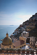 View of Positano, the Amalfi Coast, Li Galli Islands and the Tyrrhenian Sea from Le Sirenuse Hotel patio, Positano, Campania, Italy.