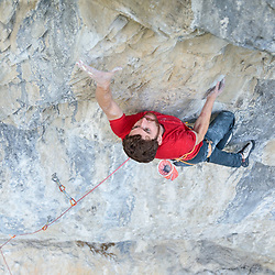 Zak McGurk climbing Iron Butterfly 5.14 c/d at Planet X in Canmore, AB