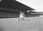 Play kicks ball during the Down v Offaly All Ireland Senior Gaelic Football Final in Croke Park on 24th September 1961. Down 3-6 Offaly 2-8.