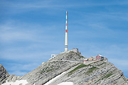 View Säntis (2120 m) from Rotsteinpass in Switzerland, Europe. A transmission tower caps Säntis (2502 m), the highest mountain in the Alpstein massif of northeastern Switzerland, and highest of the Appenzell Alps. Appenzell Innerrhoden is Switzerland's most traditional and smallest-population canton (second smallest by area).