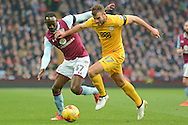 Preston North End defender Tommy Spurr (17) battles for possession with Aston Villa midfielder Albert Adomah (37) 0-0 during the EFL Sky Bet Championship match between Aston Villa and Preston North End at Villa Park, Birmingham, England on 21 January 2017. Photo by Alan Franklin.
