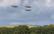 Members of the public watch from the hills tops as Spitfires and other World War II aircraft take off from Goodwood airfield near Chichester as the country marked the 75th anniversary of the Battle of Britain. <br /> Picture date Tuesday 15th September, 2015.<br /> Picture by Christopher Ison. Contact +447544 044177 chris@christopherison.com