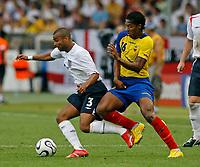 Photo: Glyn Thomas.<br />England v Ecuador. 2nd Round, FIFA World Cup 2006. 25/06/2006.<br /> England's Ashley Cole (L) and Ecuador's Luis Valencia.