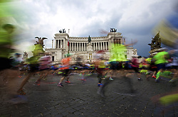 ROME, April 2, 2017  Runners pass Piazza Venezia (Venice Square) during the 23rd Marathon of Rome in Italy, on April 2, 2017. (Credit Image: © Jin Yu/Xinhua via ZUMA Wire)