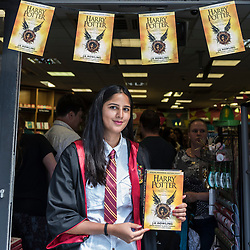 """© Licensed to London News Pictures. 31/07/2016. London, UK.  A store member, dressed in costume, greets fans of the Harry Potter books series visiting Waterstones bookshop in Harrow to buy the """"Harry Potter and the Cursed Child"""", the script, in book form, of the play by JK Rowling. Photo credit : Stephen Chung/LNP"""
