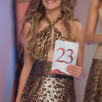 Contestant Fanni Weisz reacts to winning the special prize title Miss Hungary International during the joint Beauty Queen contest in Hungary's tv2 television headquarter in Budapest, Hungary on July 14, 2011. ATTILA VOLGYI