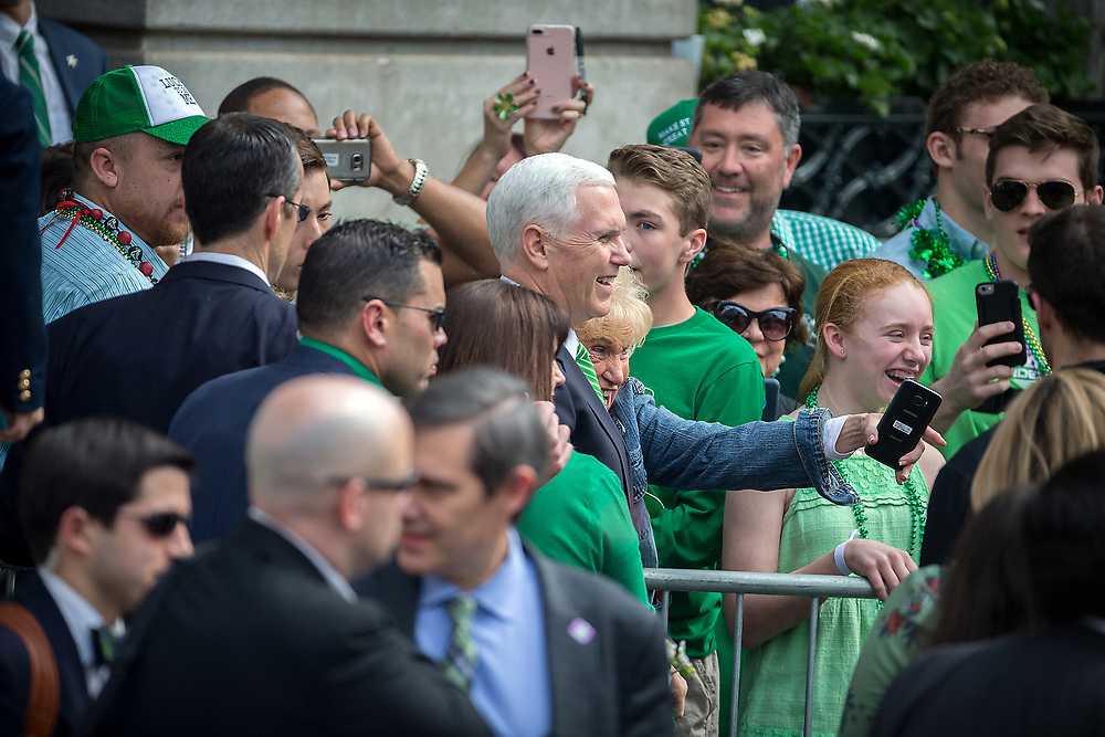 Vice President Mike Pence and his wife Karen Pence wave from a balcony at City Hall, Saturday, March 17, 2018, during the St. Patrick's Day parade in Savannah, Ga. Irish immigrants to Savannah and their descendants have been celebrating St. Patrick's Day with a parade since 1824. (AP Photo/Stephen B. Morton)