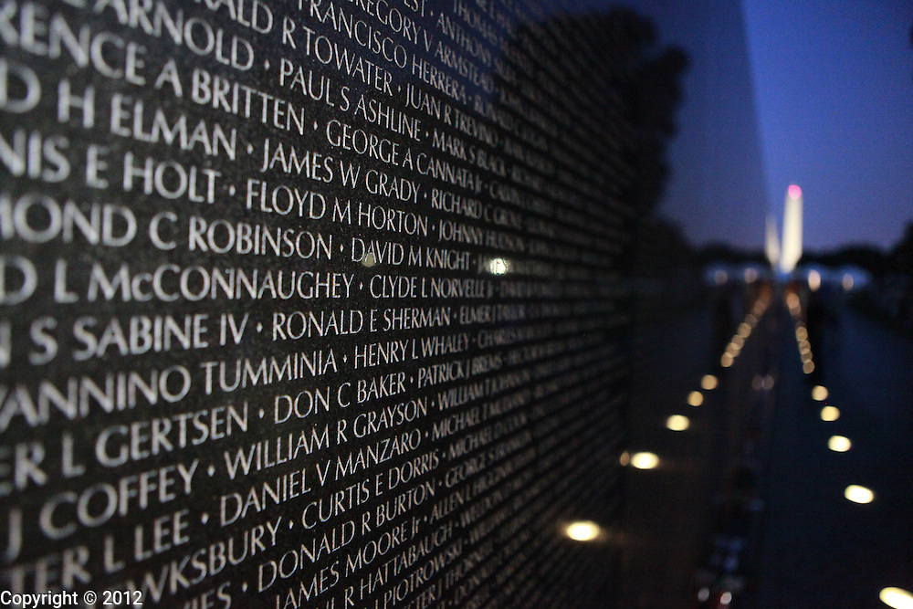 Names of the dead are engraved in stone at the Vietnam Veterans Memorial Wall.
