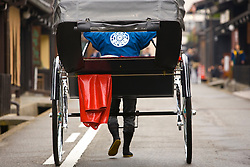 Asia, Japan, Gifu prefecture, Takayama (also known as Hida-Takayama), rickshaw and driver, viewed from behind