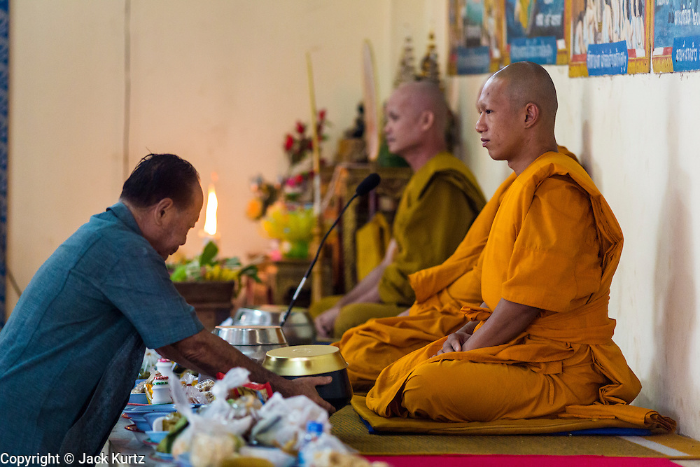 24 MAY 2013 - MAE SOT, THAILAND:    Monks lead a service at Wat Mae Pa in Mae Sot on Visakha Puja Day. Visakha Puja (Vesak) marks three important events in the Buddha's life: his birth, his attainment of enlightenment and his death. It is celebrated on the full moon of the sixth lunar month, usually in May on the Gregorian calendar. This year it is on May 24 in Thailand and Myanmar. It is celebrated throughout the Buddhist world and is considered one of the holiest Buddhist holidays.    PHOTO BY JACK KURTZ
