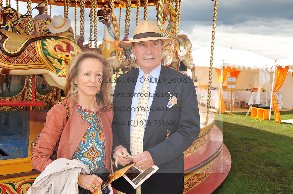 MR & MRS JULIAN HIPWOOD at the 2012 Veuve Clicquot Gold Cup Final at Cowdray Park, Midhurst, West Sussex on 15th July 2012.