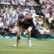 LONDON, ENGLAND - JULY 13:  A ball girl in action on Center Court during the Wimbledon Lawn Tennis Championships at the All England Lawn Tennis and Croquet Club at Wimbledon on July 13, 2017 in London, England. (Photo by Tim Clayton/Corbis via Getty Images)