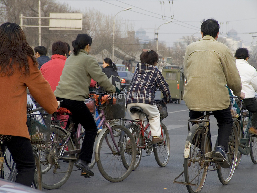 China Beijing people bicycling in the morning to there jobs