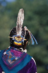 United States, Washington, Seattle. Native American woman at annual Seafair powwow with braids, beaded hair ornament and feather