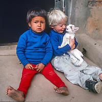 Ben Wiltsie and a Nepali girl sit in a door near Kathmandu, Nepal, 1986.