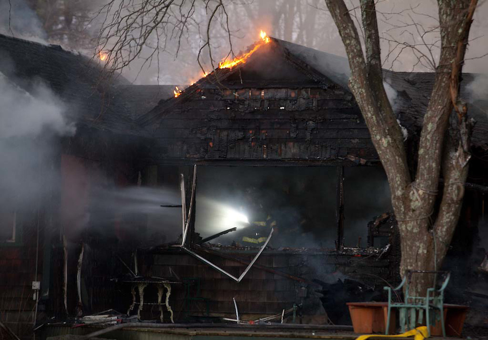 Milton, MA 03/21/2012.Firefighters battle a 3 alarm fire in the 1400 block of Canton Ave. on Wednesday evening..Alex Jones / For The Patriot Ledger