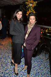 Left to right, sisters EVANGELINE LING and BIP LING at a party to celebrate the first anniversary of SushiSamba at the Heron Tower, 110 Bishopsgate, London EC4 on 12th November 2013.