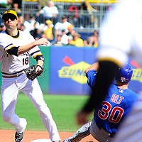 Pittsburgh Pirates second baseman Neil Walker (18) makes the out on Chicago Cubs third baseman Mike Olt (30) and throws to first for the triple play in the fourth inning against the against the Chicago Cubs at PNC Park in Pittsburgh, on September 14, 2014.  UPI/Archie Carpenter