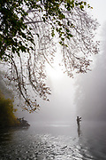 Parker Jefferson fishing BC's Cowichan River during October fog.
