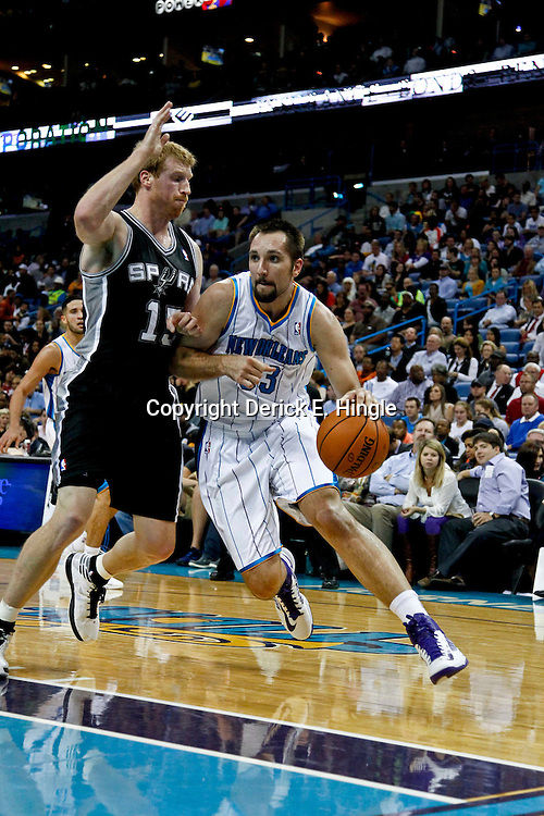 October 31, 2012; New Orleans, LA, USA; New Orleans Hornets power forward Ryan Anderson (33) drives past San Antonio Spurs power forward Matt Bonner (15) during the first half of a game at the New Orleans Arena. Mandatory Credit: Derick E. Hingle-US PRESSWIRE