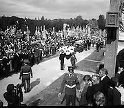 Funeral of Eamon DeValera.   (J72)..1975..02.09.1975..09.02.1975..2nd September 1975..Today saw the funeral of Eamon DeValera. He was laid to rest beside his wife Sinead in Glasnevin Cemetery,Dublin. Dignitries from all around the world attended at the funeral...Image of the military organising a clear pathway as the Tricolour draped coffin moves toward its final resting place.