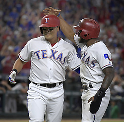 September 8, 2017 - Arlington, TX, USA - The Texas Rangers' Elvis Andrus two-run single scores teammates Delino DeShields, right, and Shin-Soo Choo during the fifth inning against the New York Yankees at Globe Life Park in Arlington, Texas, on Friday, Sept. 8, 2017. (Credit Image: © Max Faulkner/TNS via ZUMA Wire)