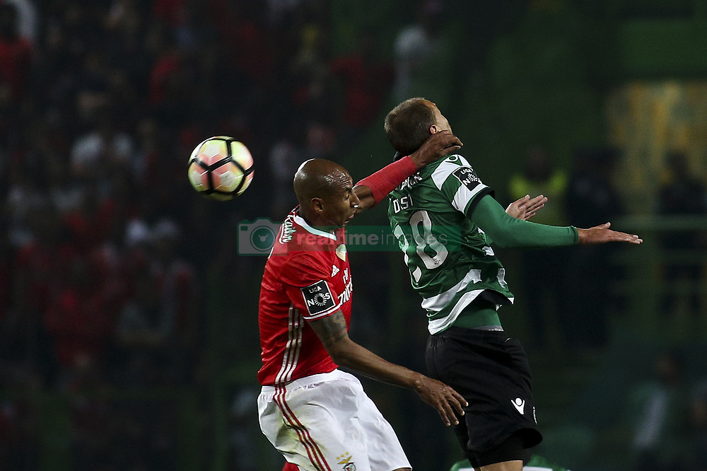 April 22, 2017 - Lisbon, Portugal - Sporting's forward Bas Dost (R) vies with Benfica's Brazilian defender Luis Da silva 'Luisao' during the Portuguese League  football match between Sporting CP and SL Benfica at Jose Alvalade  Stadium in Lisbon on April 22, 2017. (Credit Image: © Carlos Costa/NurPhoto via ZUMA Press)