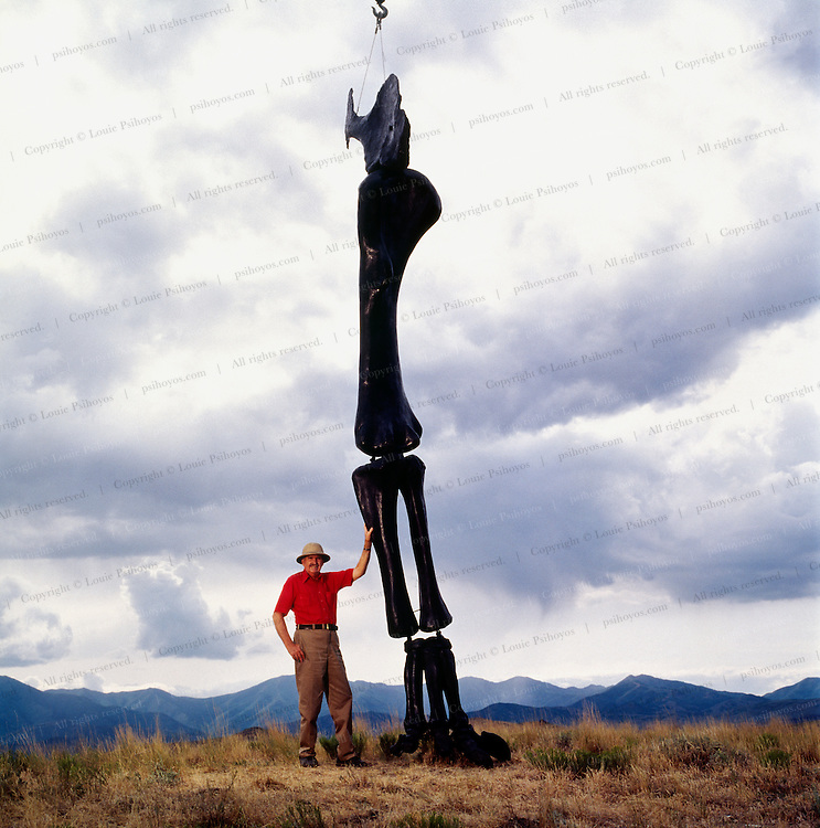 Jim Jensen has excavated the shoulder blade of an animal, from Dry Mesa Quarry in Colorado, Ultrasaurus, perhaps the largest animal to ever walk the earth.  He stands with the extrapolated cast of its foreleg hung from a crane.