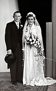 formal studio portrait of newly wed couple 1960s