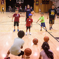 First and second graders running basketball drills in the gym at Rehoboth Christian School, Wednesday July 18 at the True Hoops Basketball Camp.