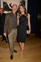 ELIZABETH HURLEY and PATRICK COX at the Christie's Conservation Lectures in aid of Tusk held atChristie's, 8 King Street, London on 30th April 2014.