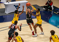 Jan 25, 2021; Morgantown, West Virginia, USA; Texas Tech Red Raiders guard Clarence Nadolny (3) passes the ball while defended by West Virginia Mountaineers guard Taz Sherman (12) and forward Gabe Osabuohien (3) during the first half at WVU Coliseum. Mandatory Credit: Ben Queen-USA TODAY Sports