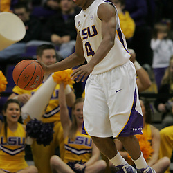 Jan 04, 2010; Baton Rouge, LA, USA; LSU Tigers guard Chris Bass (4) controls the ball during a game against the McNeese State Cowboys at the Pete Maravich Assembly Center. LSU defeated McNeese State 83-60.  Mandatory Credit: Derick E. Hingle-US PRESSWIRE