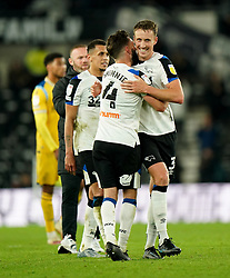 Derby County's Craig Forsyth and Derby County's Graeme Shinnie at full time after the Sky Bet Championship match at Pride park, Derby. Picture date: Wednesday September 29, 2021.