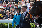 Michael Owen with Brown Panther and jockey Richard Kingscote, Glorious Goodwood. Thursday.  Sussex. 3 August 2013